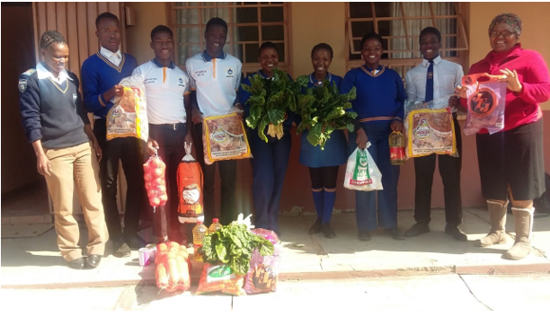 Dorm Matron and pupils receiving the care package